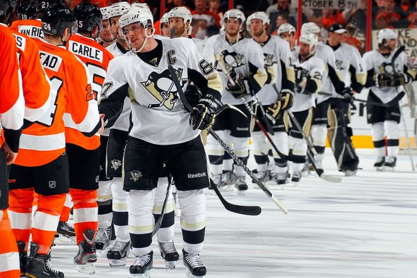 The Pittsburgh Penguins line up to shake hands with the Philadelphia Flyers post-hockey match, 2012.