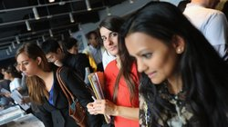 Job applicants meet potential employers at the NYC Startup Job Fair held in September. Last month, the private sector created jobs while the public sector resumed laying off workers.