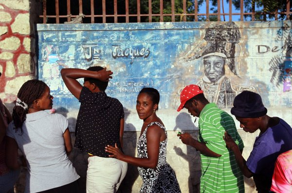 People wait to vote in Haiti&#39;s national election in Port-au-Prince, 2010.