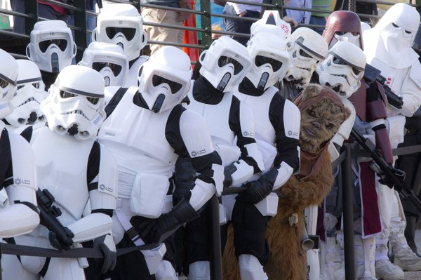 Fans dressed as Imperial Stormtroopers and one single Ewok stand in line at a Star Wars event at Legoland Windsor, England, 2012.