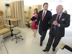 Republican Congressman Dan Lungren (center) tours a cancer center in Sacramento, Calif. Lungren is running for re-election in California's 7th Congressional District.
