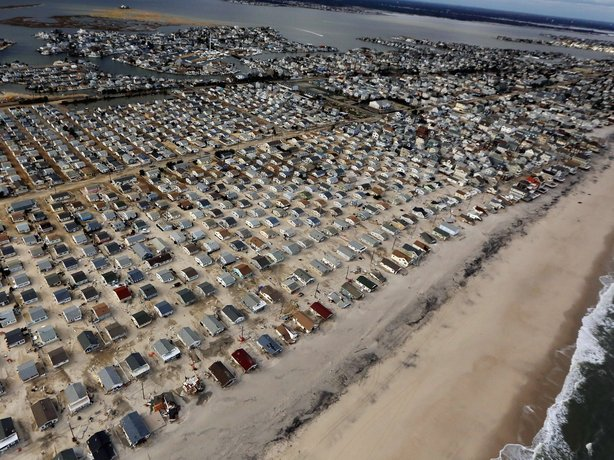 Homes are surrounded by sand washed in by Superstorm Sandy on October 31, 2012 in Seaside Heights, New Jersey.