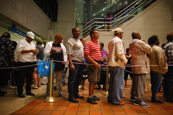 Early voters in Miami wait in line to vote in the presidential election on the first day of early voting, Oct. 27, 2012.