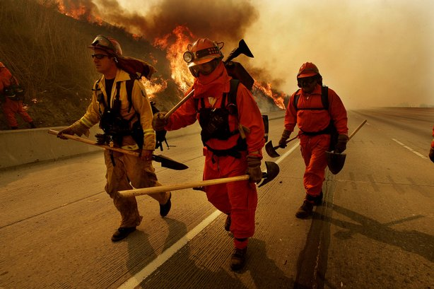 Firefighters prepare to battle a blaze November 16, 2008 in Diamond Bar, California.