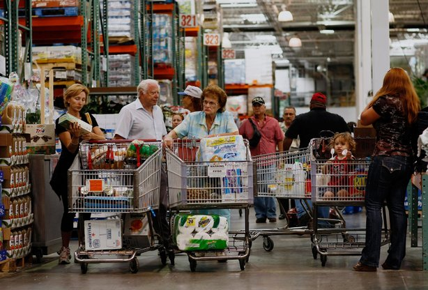 Michael Kaire (2nd L) and Sylvia Kaire (C) and others shop at a Costco store in North Miami, Florida.