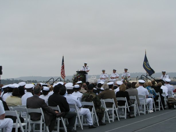 An officer talks to the crowd at the memorial service for the five Navy helicopter crew members who were killed in a crash off the coast last week. The service was held aboard the USS Midway in downtown San Diego.