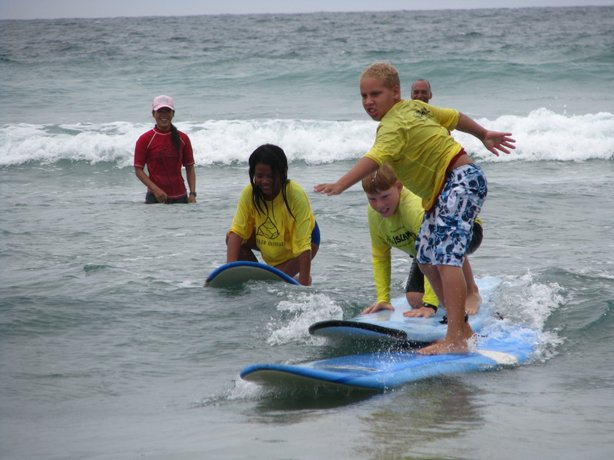 Military kids learning to surf at a Camp Yellow Ribbon.