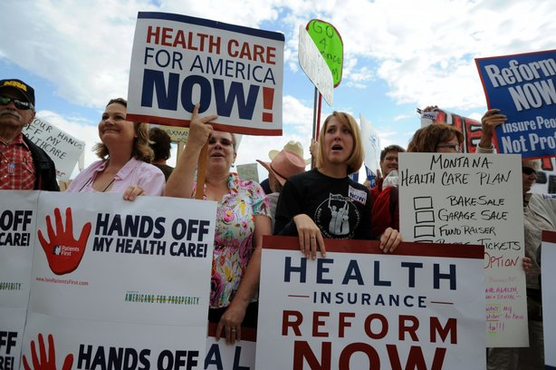 Health care reform supporters and detractors stand outside a town hall-style meeting attended by U.S. President Barack Obama in a hangar at Gallatin Field Airport on August 14, 2009 in Belgrade, Montana.