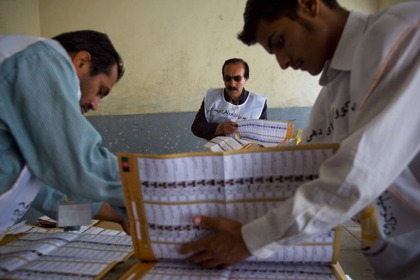 A Free & Fair Election Foundation of Afghan electoral workers count votes in a school on August 21, 2009 in Kabul, Afghanistan. Counting continues today with top presidential candidates Hamid Karzai and Abdullah Abdullah both having declared victory in Afghanistan's second democratic elections.