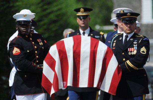 The casket with Sen. Edward Kennedy is carried by a military escort to a hearse at the Kennedy Compound, to begin a motorcade procession to Boston August 27, 2009 in Hyannisport, Massachusetts. Merrily Lunsford/Cape Cod Times-Pool/Getty Images)