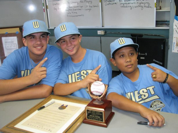 Little League world champs Luke Ramirez, Oscar Castro and Bradley Roberto pose for a snapshot at their school.