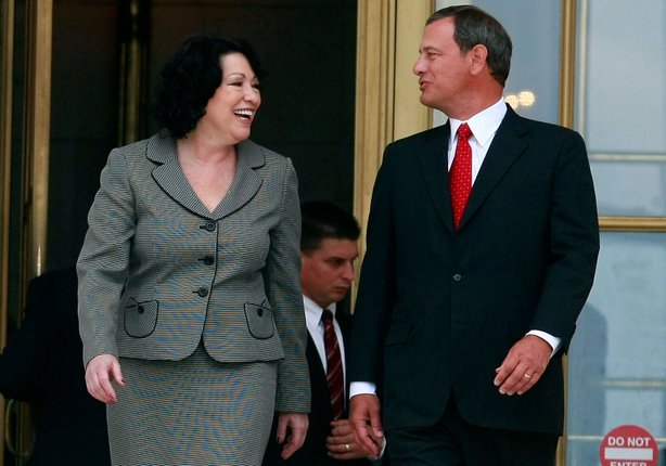 Chief Justice John Roberts (R) and Associate Justice Sonia Sotomayor walk out of the U.S. Supreme Court building after her investiture ceremony on September 8, 2009 in Washington, DC.