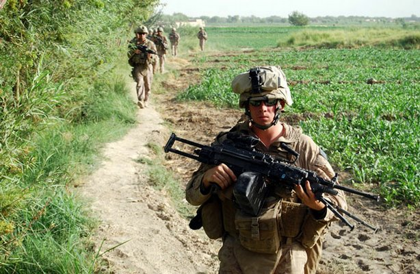 Foot patrol in Helmand, Afghanistan with Echo Company of the 2nd Battalion, 8th Marine Regiment. Marines in Helmand come under near daily attack as they attempt to clear the area.