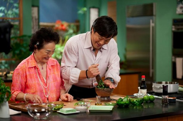 "Iris and Ming Tsai cooking in the kitchen together for the ""Simply Ming: Wonton Wrapper/Parsley"" episode."