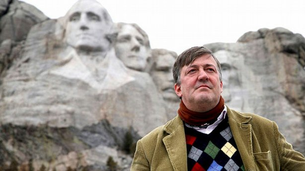 Stephen Fry stands in front of Mt. Rushmore on his journey to explore the United States.