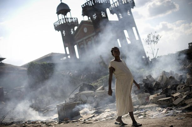 Photo of a pregnant woman walking through the rubble after the earthquake in Haiti. In the aftermath of one of the most devastating earthquakes in recorded history, survivors in Haiti were left without food, water or shelter.
