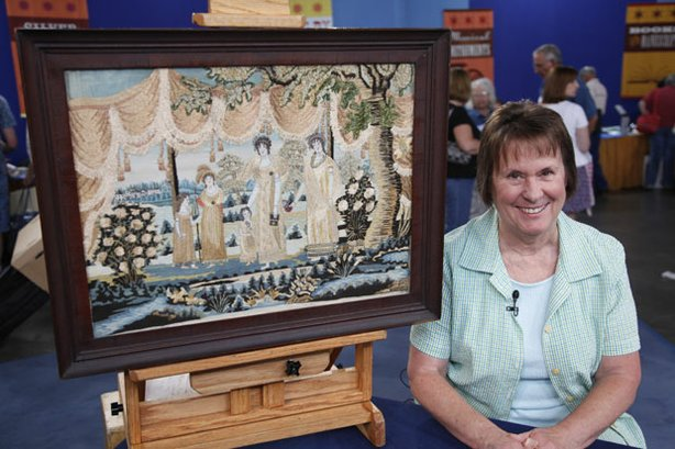 "At ""Antiques Roadshow"" in Denver, Colorado, this guest brings a needlework family portrait made by her great-great-grandmother in 1817. Appraiser Allan Katz marvels at the piece's extraordinary composition and condition and assigns it a value of $40,000 to $70,000."