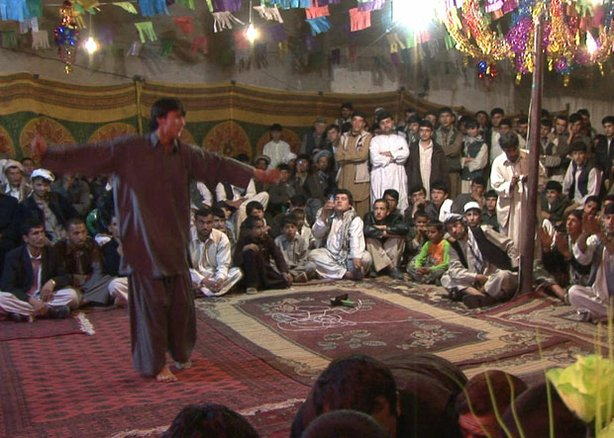 An illegal &quot;Dancing Boy&quot; party in Takhar, northern Afghanistan. The boy, Abdullah, 13, is &quot;owned&quot; by a local businessman.