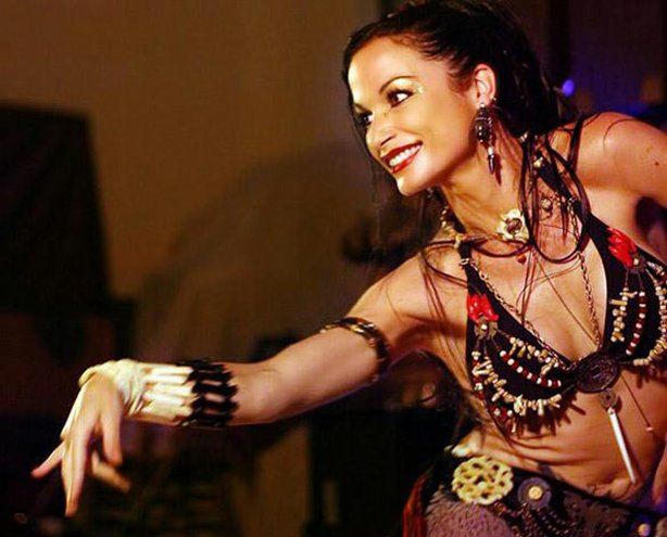 Bellydancer Sabrina Fox performing in costume. Sabrina is known for being one of the top performers and instructors in the arena of tribal bellydance, and tours the world with the Bellydance Superstars.