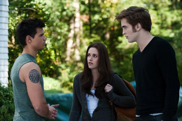 "Bella (Kristen Stewart center) declares herself Switzerland as her romantic rivals Jacob (Taylor Lautner) and Edward (Robert Pattinson) continue to fight over her in ""Eclipse."""