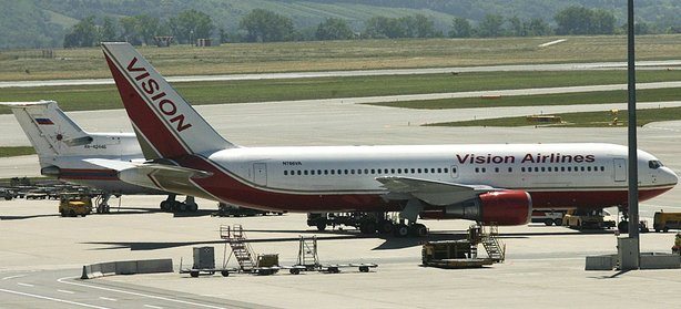 A Vision airlines plane presumed to be carrying 10 men and women who worked as Russian spies in the United States sits on the tarmac at Vienna airport where it parked next to a Russian jetplane.