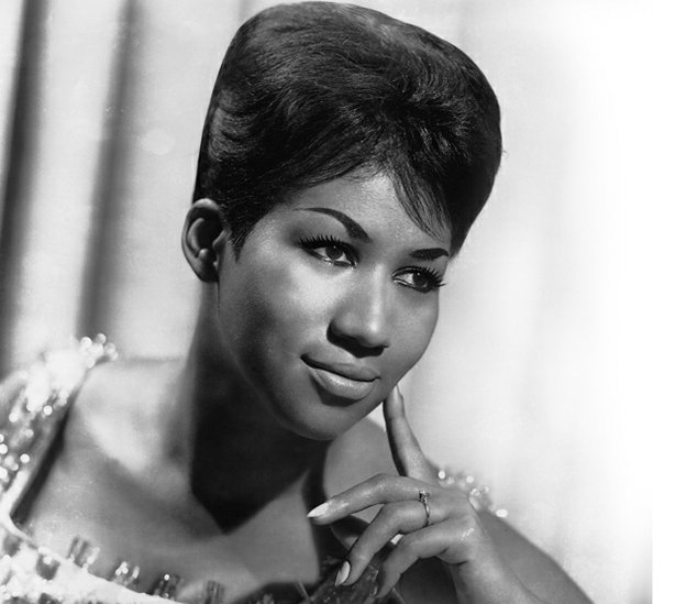 A black and white publicity photo of Aretha Franklin, the Queen of Soul.