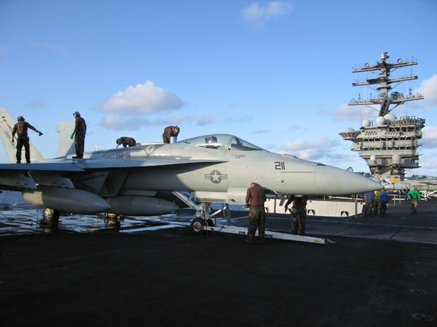 Airmen maintain an F/A-18E Hornet, flown by Strike Fighter Squadron 14 (VFA-14), aka &quot;The Top Hatters,&quot; aboard the USS Nimitz.