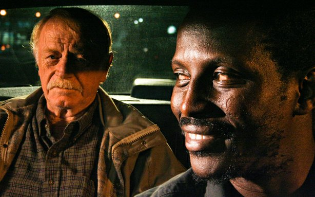 "William (Red West) and Solo (Souléymane Sy Savané) in Solo's cab. Solo drives William to a mountaintop where he plans to commit suicide. Through this unlikely, but unforgettable friendship, ""Goodbye Solo"" deftly explores the passing of a generation, as well as the rapidly changing face of America."