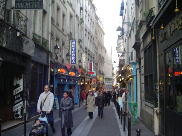 A small street in the Latin Quarter with bistros and restaurants, Paris, 2003.