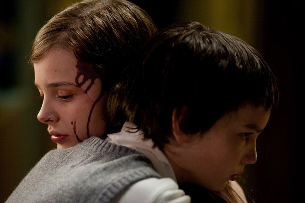 "Chloe Grace Moretz and Kodi Smit-McPhee star in ""Let Me In."""