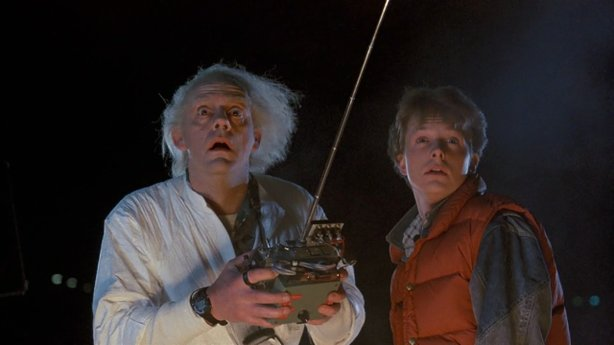 "Christopher Lloyd as Doc Brown and Michael J. Fox as Marty McFly in ""Back to the Future."""
