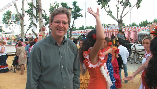 Photo of Rick Steves at a vibrant festival that takes place every April, in Sevilla, Spain