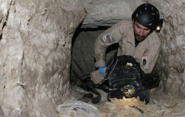 In this photo released by Immigration and Customs Enforcement, an agent with ICE Homeland Security Investigations tests the safety of the air in the drug-smuggling tunnel discovered in Otay Mesa, California on November 3, 2010.