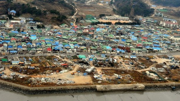 Destroyed houses are seen Wednesday on Yeonpyeong Island, South Korea, following artillery exchange between North and South Korea on Tuesday.