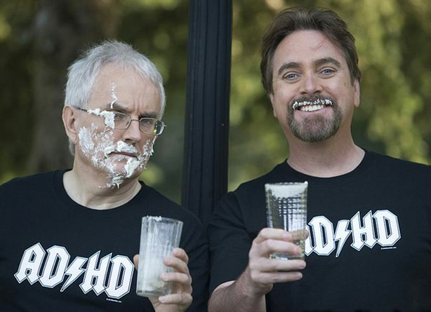 A photo of actor/comedian Rick Green and Canadian comedy legend Patrick McKenna wearing ADHD t-shirts.