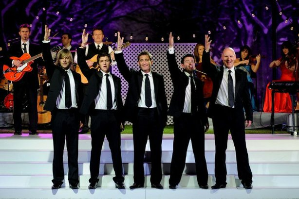 "Promotional photo of Celtic Thunder on stage for ""Celtic Thunder Christmas,"" filmed in Poughkeepsie, N.Y. in front of a live audience."