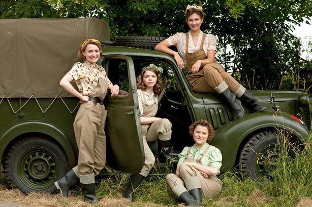 Annie Barratt played by Christine Bottomley; Bea Holloway played by Jo Woodcock; Joyce Fisher played by Becci Gemmell; Nancy Morrell played by Summer Strallen from the television series LAND GIRLS.