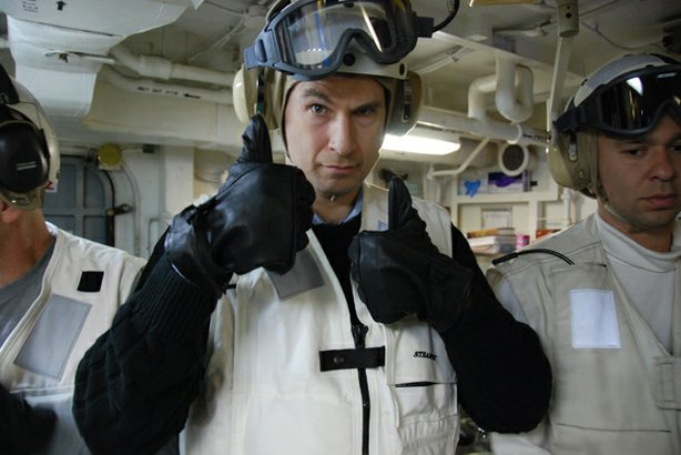 "David Pogue, host of NOVA ""Making Stuff,"" on an aircraft carrier. Pogue travels from the deck of a U.S. naval aircraft carrier to a demolition derby to the country's top research labs to check in with experts who are re-engineering what nature has given us to create the next generation of strong stuff."