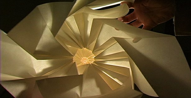 Material artist Chris K. Palmer experiments in paper with pattern, movement and a flood light.
