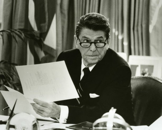 President Ronald Reagan at his desk in the White House. &quot;Reagan,&quot; is a two-part biography of the actor, governor and president who saw America as &quot;a shining city on a hill,&quot;a beacon of freedom to a world in need of rescue.