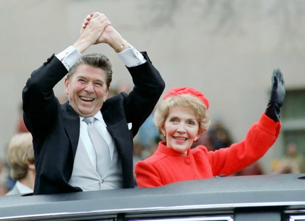 President Reagan and Nancy Reagan wave from their limousine during the Inaugural Parade in Washington, DC, January 20, 1980.