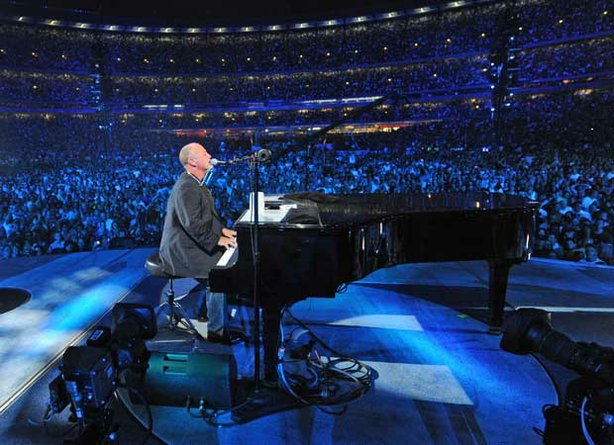 Superstar Billy Joel at his piano performing in New York City's Shea Stadium in July 2008.
