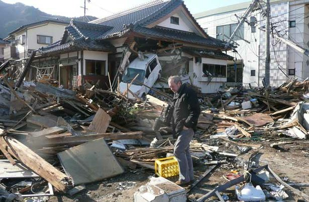 Callum Macrae stands amid destruction and debris in Ofunato, Japan.