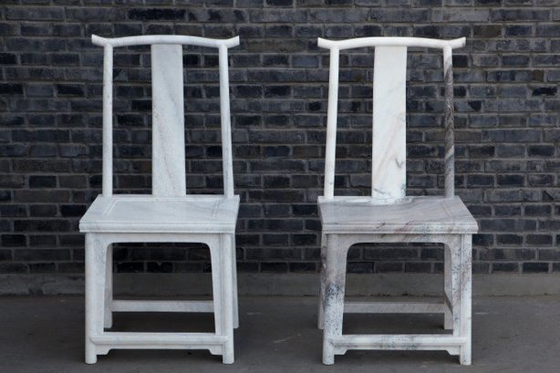 "Two chairs from Chinese artist Ai Weiwei's ""Marble Chair"" series, currently on view at MCASD."
