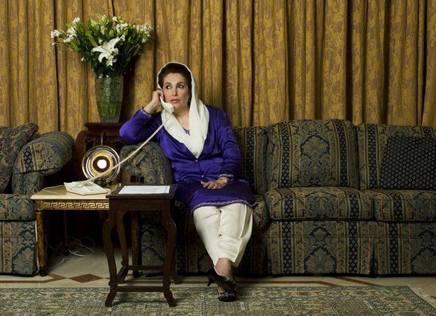 "Benazir Bhutto sits on a couch talking on the phone. ""Bhutto"" is the epic tale of the life and tragic death of Benazir Bhutto, who broke the Islamic glass ceiling as the first woman leader of a Muslim country."