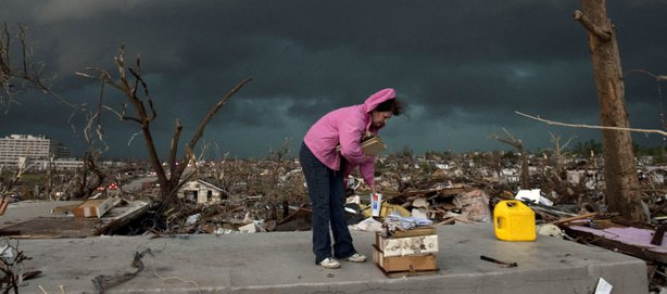 Janet Martin attempts to salvage medication and mementos from her brother's home before a second storm moves in, on May 23, 2011 in Joplin, Missouri.