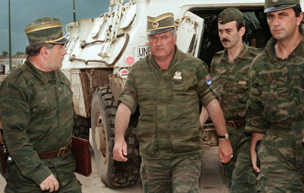 Gen. Ratko Mladic (center), commander of the Serbian forces in Bosnia, arriving at Sarajevo&#39;s airport in this photo taken Aug. 10, 1993.