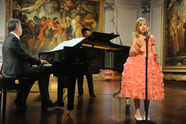 Jackie Evancho performs on stage  with co-host and music director David Foster, at The John and Mable Ringling Museum of Art in Sarasota, Florida.