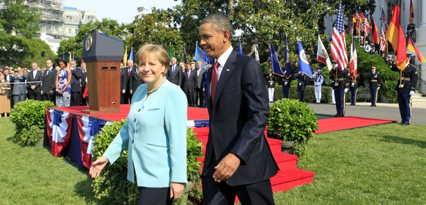 U.S. President Barack Obama (R) and German Chancellor Angela Merkel walk off the podium during a welcoming ceremony on the South Lawn of the White House June 7, 2011 in Washington, DC.