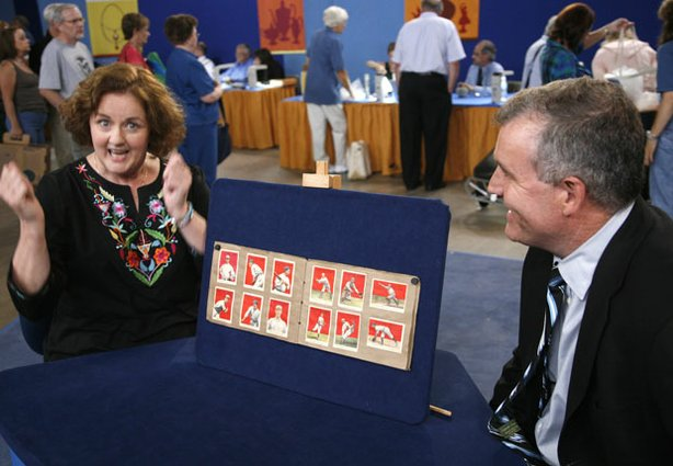 At the &quot;Antiques Roadshow&quot; event in Wichita, Kansas, this lucky guest (left) is certainly surprised when told rare hall-of-famers are among her collection of 1914 and 1915 Cracker Jack baseball cards. Appraiser Brian Marren points out Joe Jackson, Ty Cobb, Honus Wagner and an extremely rare 1914 Christy Mathewson card and estimates the entire collection could score $30,000 to $40,000.
